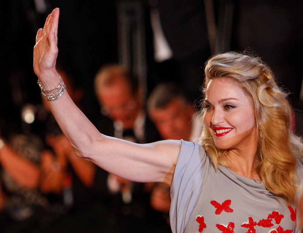 . Singer Madonna waves to her fans as she arrives for the premiere of her movie W.E. at the 68th edition of the Venice Film Festival in Venice, Italy, Thursday, Sept. 1, 2011. (AP Photo/Andrew Medichini)
