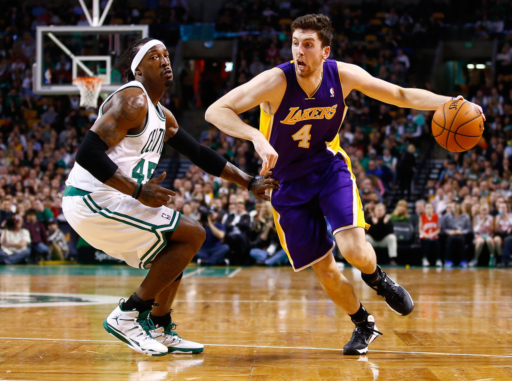 . BOSTON, MA - JANUARY 17: Ryan Kelly #4 of the Los Angeles Lakers drives to the basket past Gerald Wallace #45 of the Boston Celtics in the second half during the game at TD Garden on January 17, 2014 in Boston, Massachusetts.   (Photo by Jared Wickerham/Getty Images)