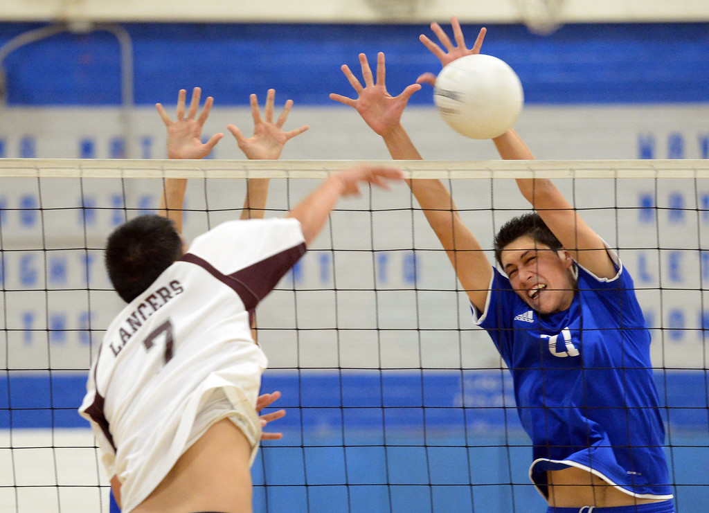 . El Rancho\'s Javier Torres (#21) blocks a shot from Bell Gardens\' Joseph Sagastume (#7) in their non-league game at El Rancho High School in Pico Rivera on Friday March 28, 2014. Bell Gardens defeated El Rancho 3-2 games. (Staff Photo by Keith Durflinger/Whittier Daily News)