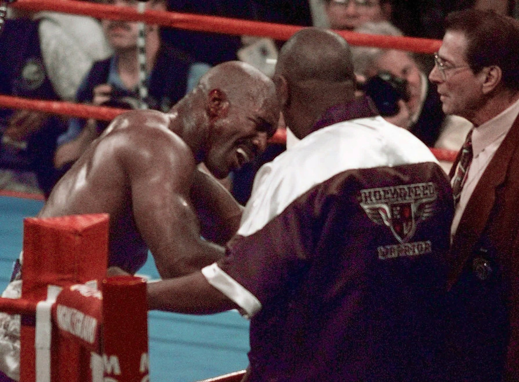 . Evander Holyfield reacts after he was bit in the ear by Mike Tyson in the third round of their WBA Heavyweight match Saturday, June 28, 1997, at the MGM Grand in Las Vegas.  (AP Photo/Jack Smith)