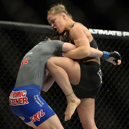 Photos: Ronda Rousey defeats Sara McMann in first round at UFC 170