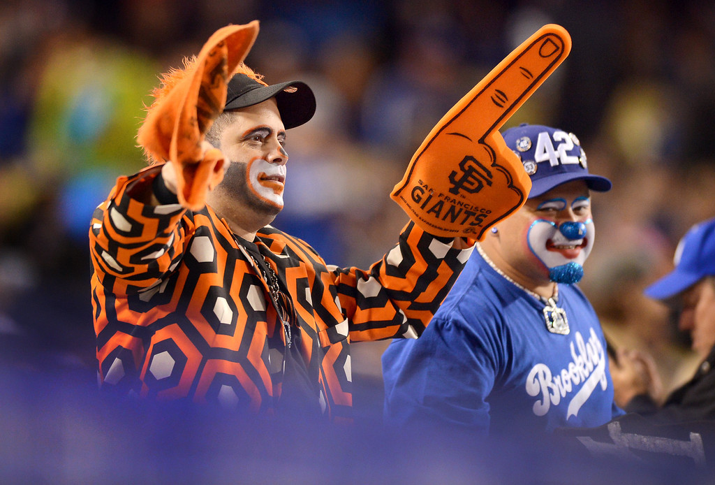 . Baseball fans support ther team at Dodger Stadium April 2, 2013.  The Giants defeated the Dodgers 3-0 Tuesday night.(Andy Holzman/Staff Photographer)