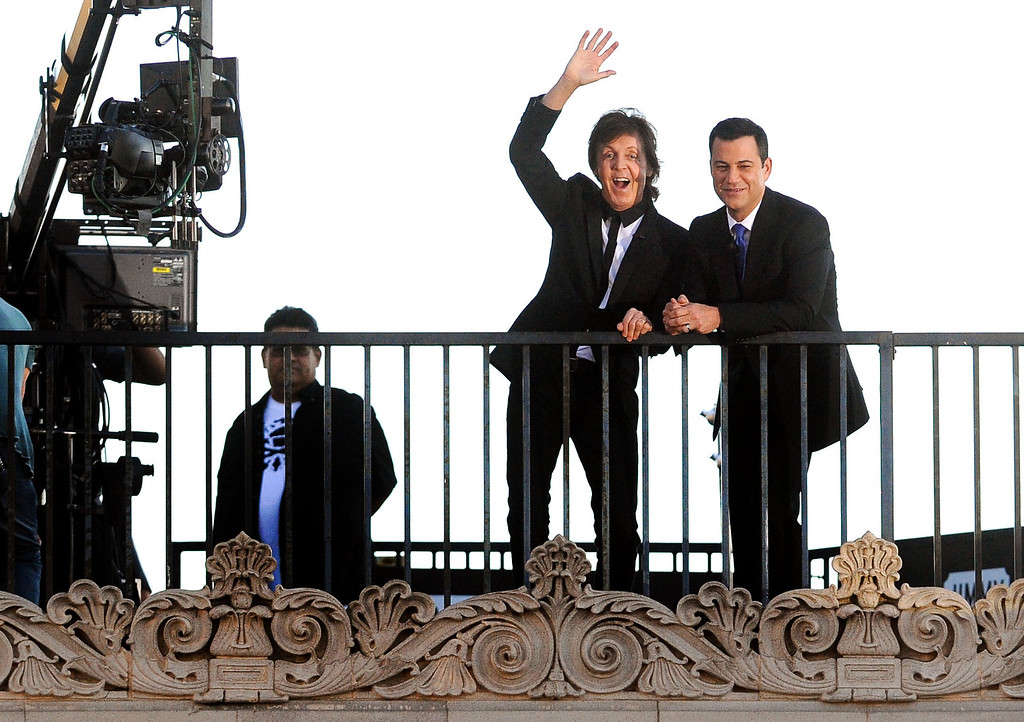 . Paul McCartney and Jimmy Kimmel are seen on a rooftop prior to McCartney\'s performance on Hollywood Boulevard in Hollywood, CA Monday, September 23, 2013.  A portion of Hollywood Boulevard will be closed from Highland to Orange through Wednesday morning to make way for two concerts planned for �Jimmy Kimmel Live.� (Andy Holzman/Los Angeles Daily News)