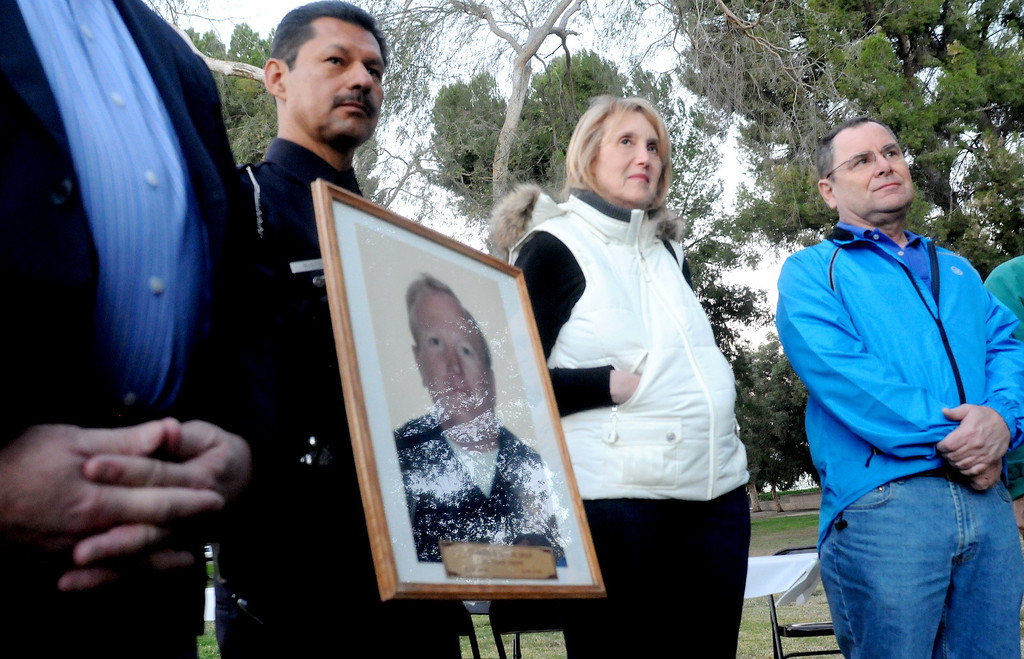 ". LAPD Detective, William Bustos holds a photo of Officer Wayne Clarence Dean, who was killed on his way to aid in rescue efforts following the Northridge earthquake.  Bustos shared stories of his colleague during the program. Councilman Mitch Englander, other officials and residents recalled the 1994 Northridge earthquake, 20 years later, by lighting luminaries and sharing ""After Stories\"" during the dawn event at Northridge Recreation Center on Friday, January 17, 2014.  (Photo by Dean Musgrove/Los Angeles Daily News)"