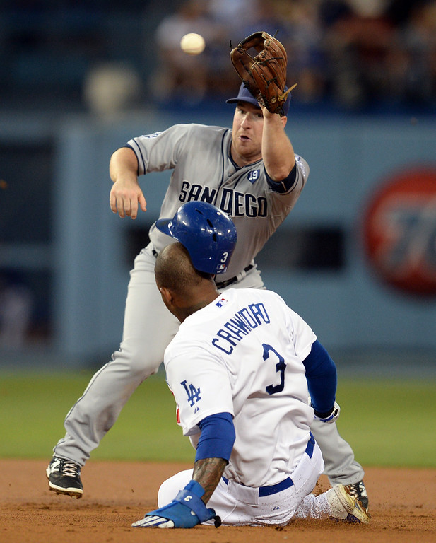. The Padres� Jedd Gyorko #9 grabs the throw and tags out the Dodgers� Carl Crawford #3 at second base on the steal attempt during their game at Dodger Stadium Thursday, August 21, 2014. (Photo by Hans Gutknecht/Los Angeles Daily News)