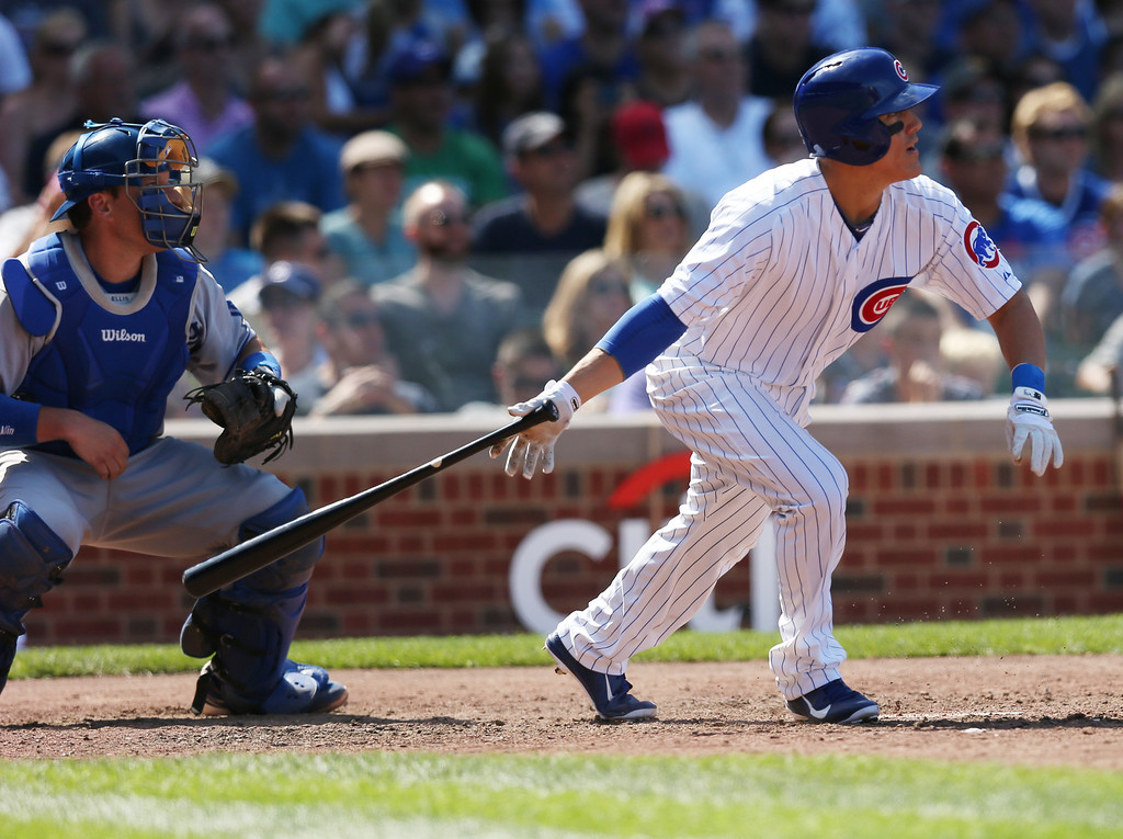 . CHICAGO, IL - AUGUST 04: Logan Watkins  #22 of the Chicago Cubs gets his first hit in his Major League debut , a single in the 6th inning, against the Los Angeles Dodgers on August 4, 2013 at Wrigley Field in Chicago, Illinois.  (Photo by Jonathan Daniel/Getty Images)