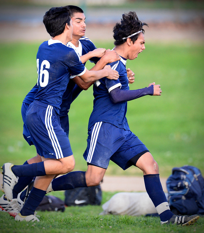 . Baldwin Park\'s Danny Vega (20) celebrates his second goal, bringing his goals for this season to 31, as they defeat Northview 2-0 during Tuesday\'s game at Northview High School, February 11, 2014. (Photo by Sarah Reingewirtz/Pasadena Star-News)