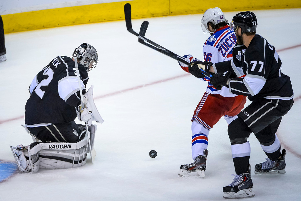 . Kings Jonathan Quick stops this shot attempt by Rangers Mats Zuccarello as Jeff Carter assists during second period action at Game 1 of the Stanley cup Finals at Staples Center Wednesday, June 4, 2014 ( Photo by David Crane/Los Angeles Daily News )