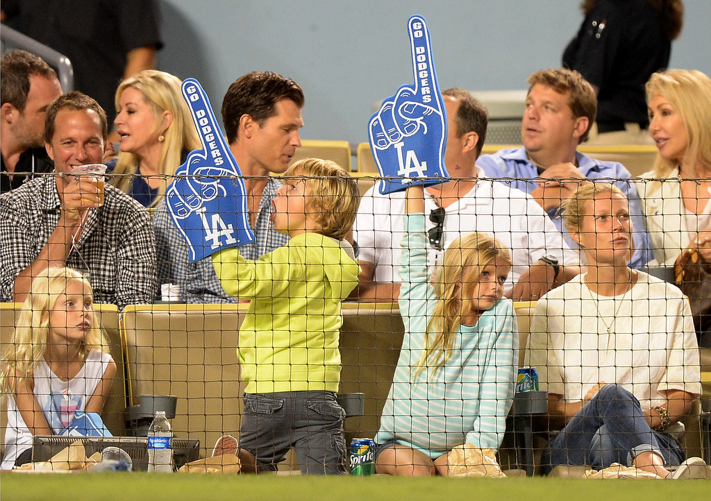 . Actress Gwyneth Paltrow and her family watch the game between the Arizona Diamondbacks and the Los Angeles Dodgers at Dodger Stadium on September 11, 2013 in Los Angeles, California.  (Photo by Harry How/Getty Images)