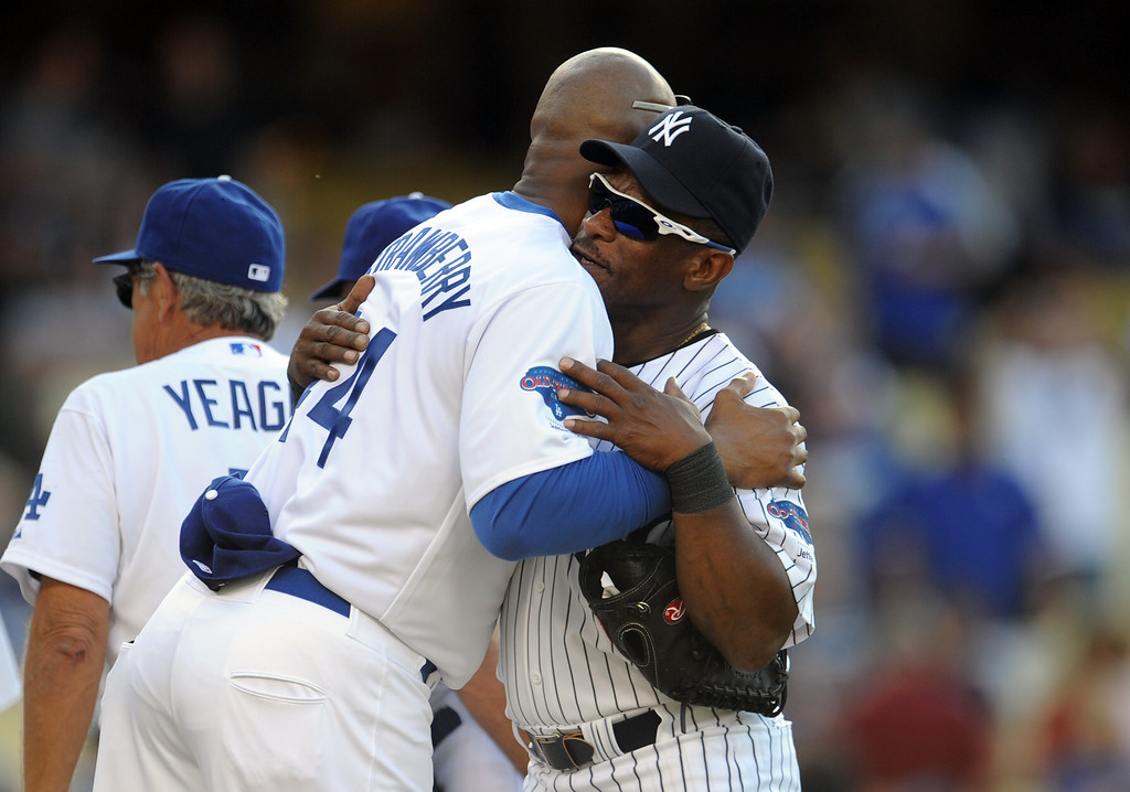 . Former Los Angeles Dodgers Darryl Strawberry hugs former New York Yankees Rickey Henderson during the Old-Timers game prior to a baseball game between the Atlanta Braves and the Los Angeles Dodgers on Saturday, June 8, 2013 in Los Angeles.   (Keith Birmingham/Pasadena Star-News)