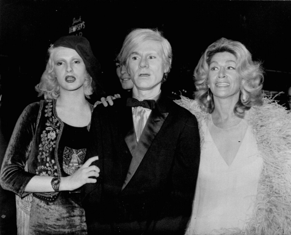 ". Notables of society, diplomacy, and entertainment gathered at the Rivoli Theatre and the Americana Hotel for the motion picture World Premiere of ""Fiddler On The Roof\"" Wednesday November 3, 1971.  The benefit performance for the Will Rogers Memorial Hospital was followed by a Champagne Supper Dance at the Americana.  Shown here, left to right, are some underground filmmakers who attended the premiere festivities:  Candy Darling, Andy Warhol, and Sylvia Miles.  (AP Photo/ho)"