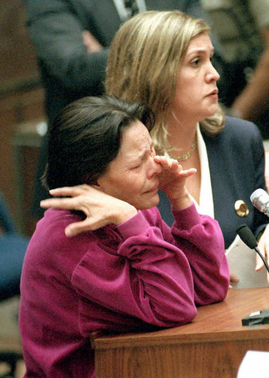. Defense witness Rosa Lopez (bottom), a former Brentwood maid who claims she saw OJ Simpson\'s white Ford Bronco parked outside his home on 12 June 1994 about the time the prosecution claims the murders of Nicole Brown Simpson and Ronald Goldman occured, cries as she addresses Judge Ito 24 February.  She will be called as a defense witness out of line 27 February after she assured the judge that she would remain in town.  Next to her is translator Doris Weitz.   (POO/AFP/Getty Images)