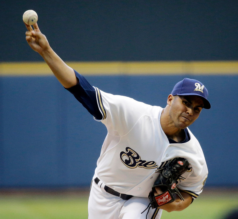 . Milwaukee Brewers starting pitcher Hiram Burgos throws during the first inning of a baseball game against the Los Angeles Dodgers Tuesday, May 21, 2013, in Milwaukee. (AP Photo/Morry Gash)