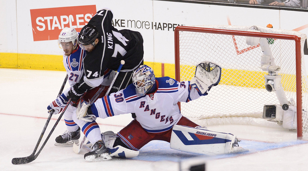 . The puck got past Rangers#30 Henrik Lundqvist Kings#74 Dwight King and Rangers#27 Ryan McDonagh off the stick of Kings#12 Marian Gaborik in the 3rd period. The Los Angeles Kings faced the New York Rangers in game 2 of the Stanley Cup Final.  Los Angeles, CA. 6/7/2014(Photo by John McCoy Daily News)