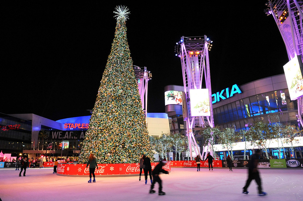. The sixth annual holiday tree lighting at L.A. LIVE was held Monday, December 2, 2013 in Los Angeles, CA.  The 66-foot tree sits in the center of the LA Kings Holiday Ice Rink -- the largest outdoor ice rink in L.A.   The rink is open daily through December 31, 2013.(Andy Holzman/Los Angeles Daily News)
