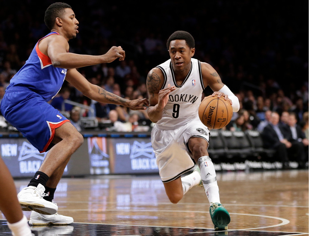 . Brooklyn Nets guard MarShon Brooks (9)  drives around a Philadelphia 76er defender in the first half of an NBA basketball game between the Philadlephia 76ers and the Brooklyn Nets, Tuesday, April 9, 2013, in New York. (AP Photo/Kathy Willens)
