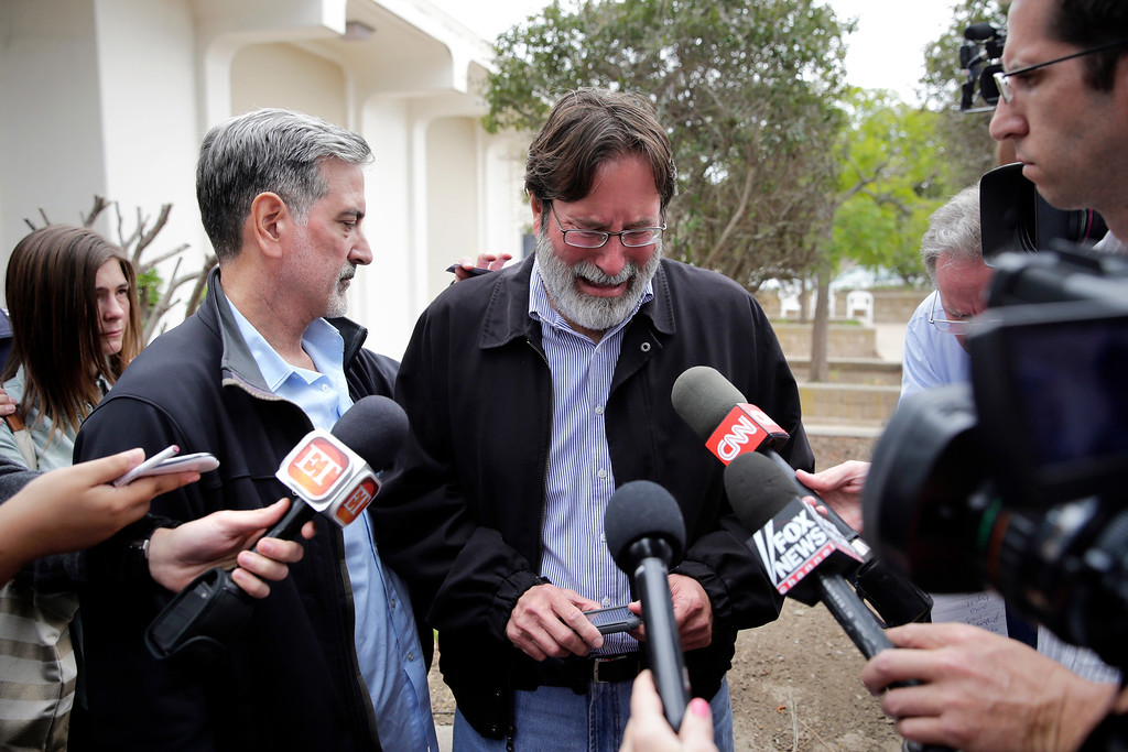 . Richard Martinez, center, who says his son Christopher Martinez was killed in Friday night\'s mass shooting that took place in Isla Vista, Calif., is comforted by his brother, Alan, as he talks to media outside the Santa Barbara County Sheriff\'s Headquarters on Saturday, May 24, 2014, in Santa Barbara, Calif. (AP Photo/Jae C. Hong)