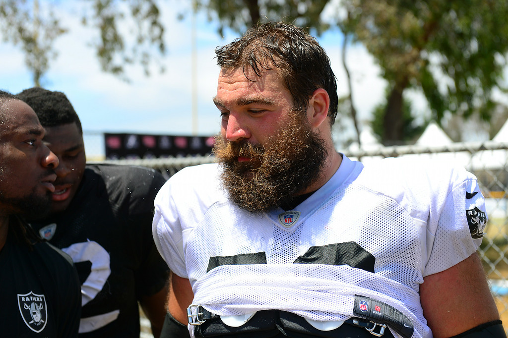 . Raider OL Jack Cornell leaves the field following the Cowboys-Raiders practice in Oxnard, Wednesday, August 13, 2014. (Photo by Michael Owen Baker/Los Angeles Daily News)