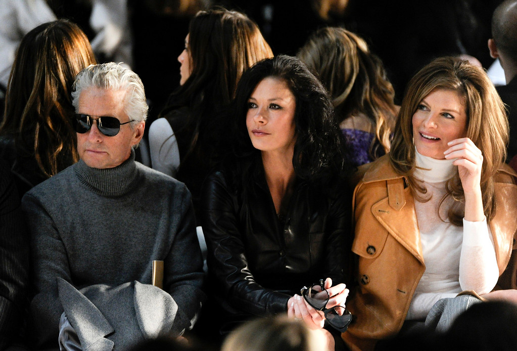 . Actors, from left, Michael Douglas, Catherine Zeta-Jones and Rene Russo attend the Michael Kors Fall 2011 fashion show during Mercedes-Benz Fashion Week on Wednesday, Feb. 16, 2011 in New York. (AP Photo/Evan Agostini)