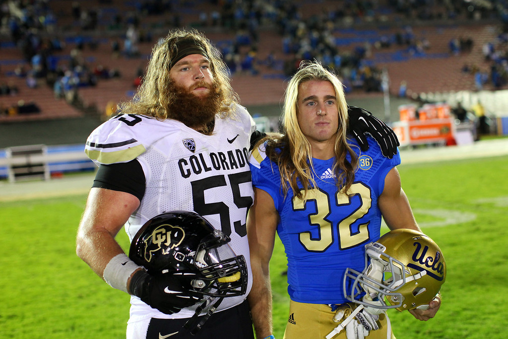 . Colorado\'s Gus Handler and brother UCLA\'s Sam Handler take a picture after the game, Saturday, November 2, 2013, at the Rose Bowl. (Photo by Michael Owen Baker/L.A. Daily News)