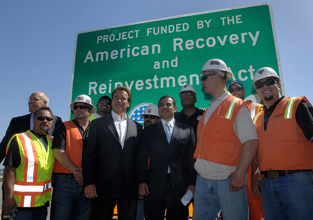 . Governor Arnold Schwarzenegger and Los Angeles Mayor Antonio Villaraigosa pose for a picture with construction workers in West Los Angeles. (May 8, 2009) (Los Angeles Daily News file photo)