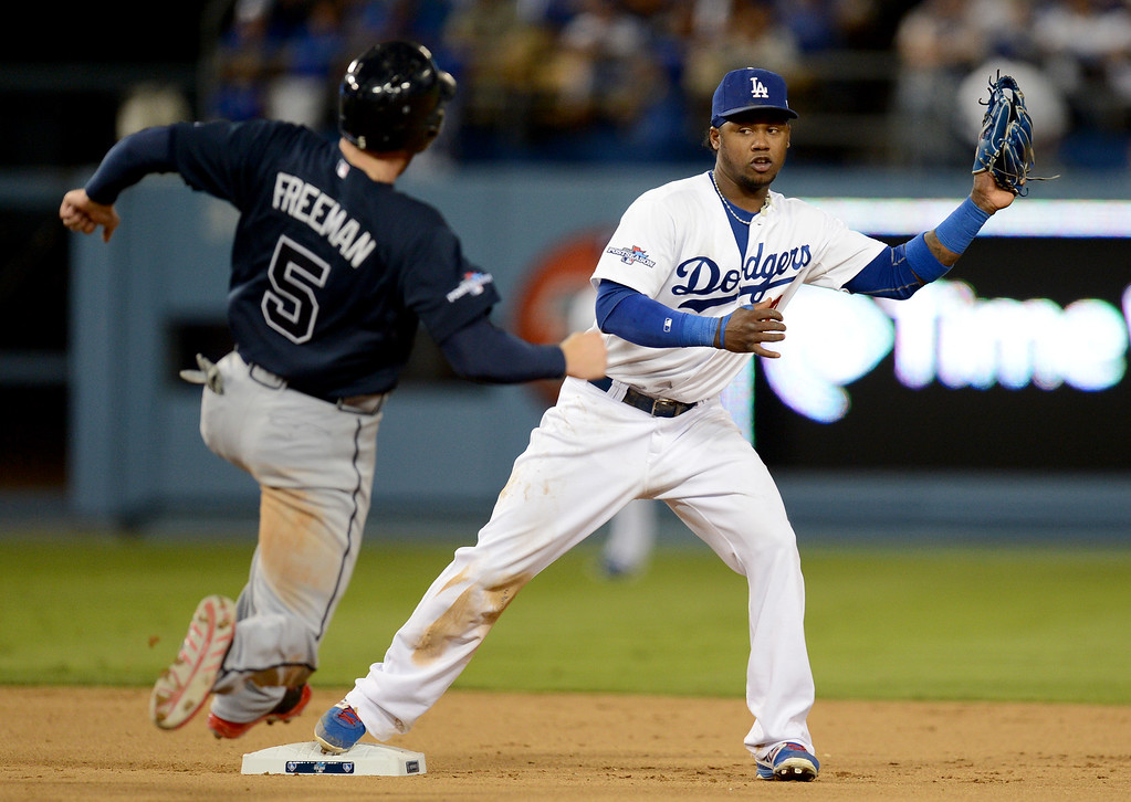 . Los Angeles Dodgers\' Hanley Ramirez outs Braves\' Freddie Freeman at second during a double play in the fifth inning during game 3 of the NLDS at Dodger Stadium Sunday, October 6, 2013. (Photo by Hans Gutknecht/Los Angeles Daily News)
