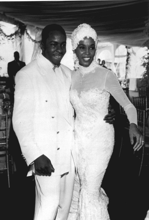 . Singer Whitney Houston, right, is seen with her husband Bobby Brown during their wedding, in this 1992 photo.  (AP Photo)