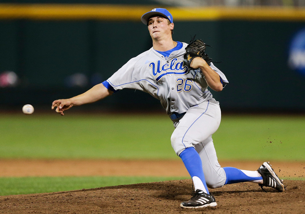 . UCLA closing pitcher David Berg delivers against Mississippi State in the ninth inning of Game 1 of the NCAA College World Series best-of-three finals, Monday, June 24, 2013, in Omaha, Neb. Berg had his 24th save as UCLA won 3-1. (AP Photo/Nati Harnik)