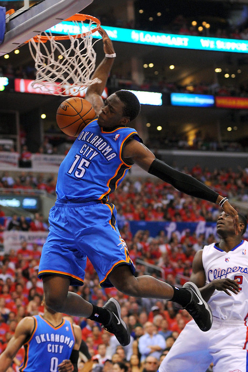 . The Thunder\'s Reggie Jackson dunks on a fastbreak, Thursday, May 15, 2014, at Staples Center. (Photo by Michael Owen Baker/Los Angeles Daily News)