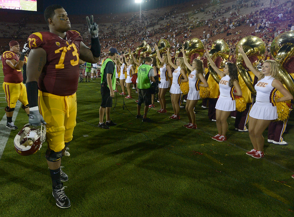 . Zach Banner gives the victory sign after the game. USC defeated Fresno State 52-13 at the Los Angeles Memorial Coliseum. Los Angeles, CA. 8/30/2014(Photo by John McCoy Daily News