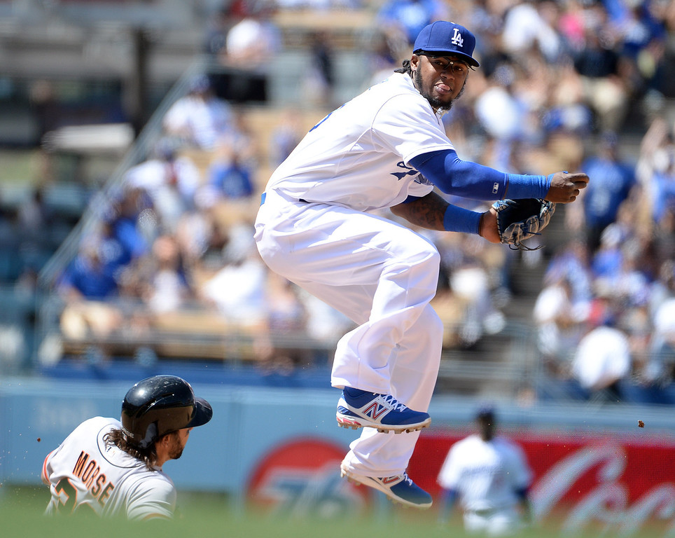 . Los Angeles Dodgers shortstop Hanley Ramirez (13) forces out San Francisco Giants\' Michael Morse (38) at second base in the fourth inning of a Major league baseball game on Saturday, May 10, 2013 in Los Angeles.   (Keith Birmingham/Pasadena Star-News)