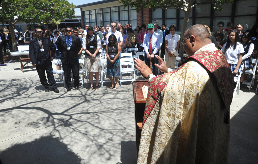 . Father John-Paul Gonzalez says a blessing as they celebrate their new $650,000 Science Center at St. Paul High School in Santa Fe Springs on Thursday May 2, 2013. The Science Program and Technology Infrastructure will enable the school to offer state-of-the-art science programs. (SGVN/Staff Photo by Keith Durflinger)