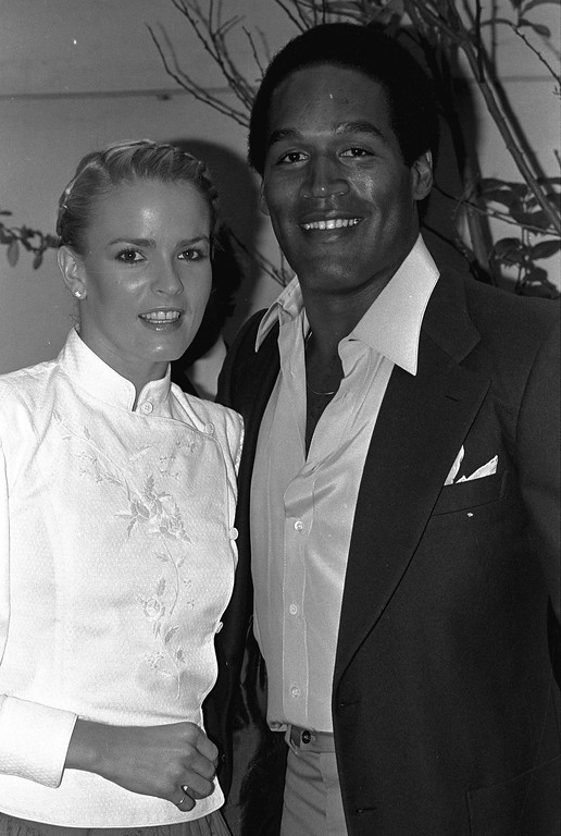 ". Former football star O.J. Simpson and friend Nicole Brown get together at party Monday night, May 6, 1980 in Beverly Hills section of Los Angeles.  The couple attended introduction party for a new geometric puzzle invented in Hungary and being distributed here as ""Rubik\'s Cube.\""  (AP Photo/Nick Ut)"