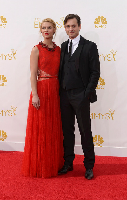 . Actors Claire Danes and Hugh Dancy on the red carpet at the 66th Primetime Emmy Awards show at the Nokia Theatre in Los Angeles, California on Monday August 25, 2014. (Photo by John McCoy / Los Angeles Daily News)