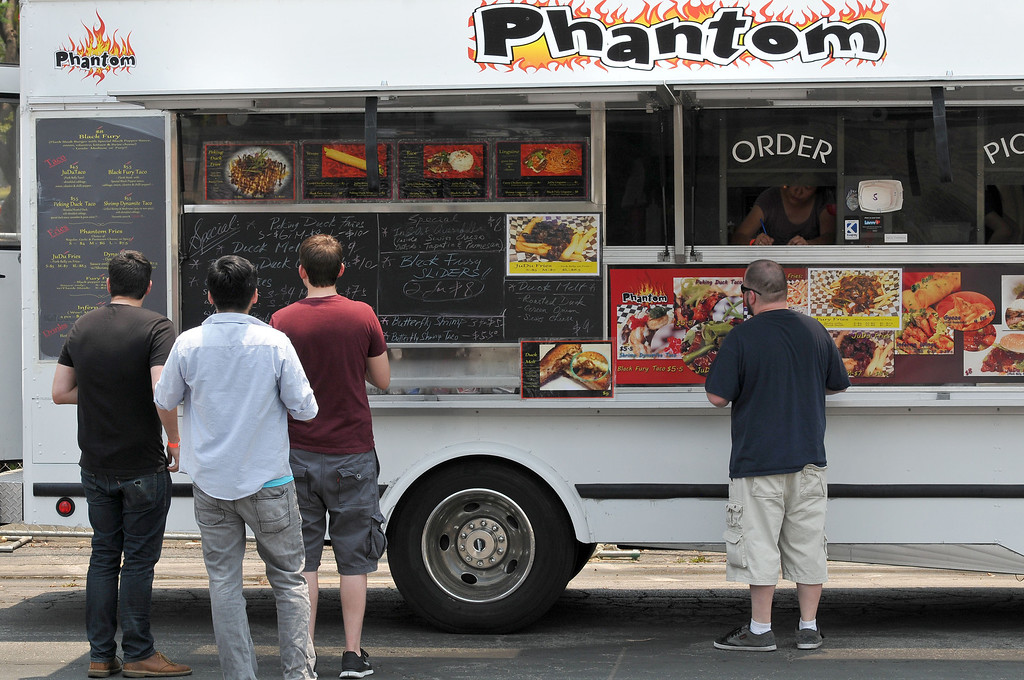 . (John Valenzuela/Staff Photographer) People order from the Phantom Food Truck during the second annual Food Truck and Brewfest in Redlands Saturday, June 29, 2013.