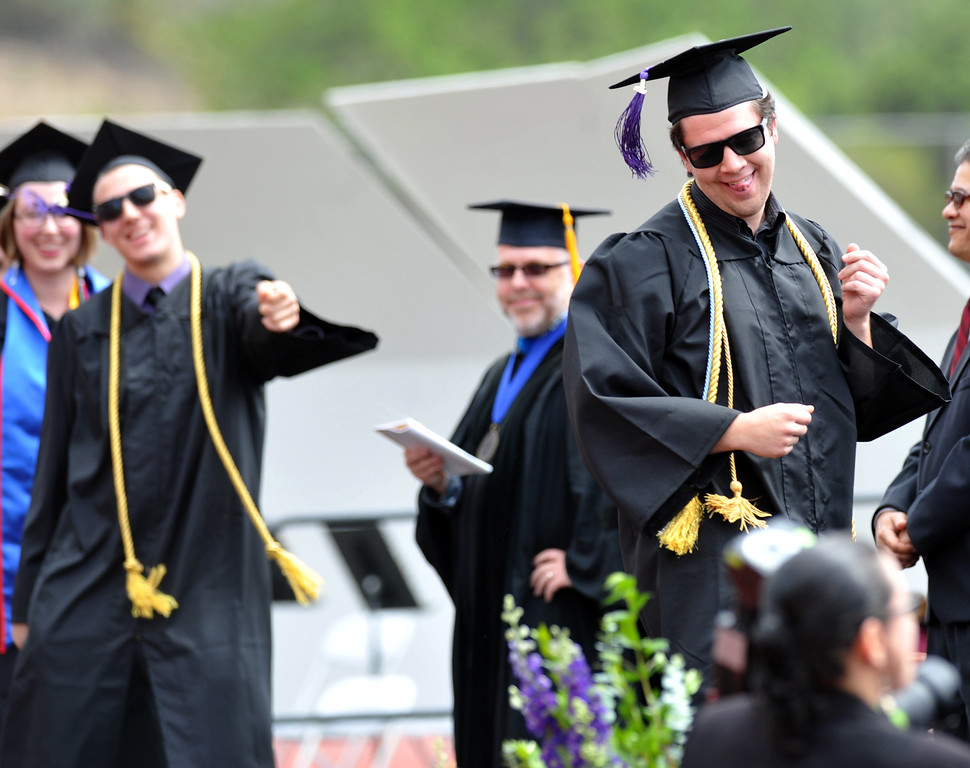 . Cameron Greene dances as his name is announces during the 110th Commencement Ceremony at Memorial Stadium on the Whittier College campus in Whittier on Friday May 17, 2013. Award-winning journalist Sonia Nazario gave the keynote address and received an honorary degree from the Whittier College faculty: a doctorate of humane letters.(SGVN/Staff Photo by Keith Durflinger)