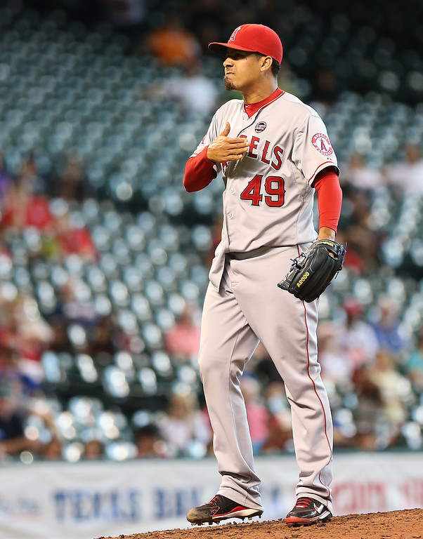 . HOUSTON, TX - SEPTEMBER 15: Ernesto Frieri #49 of the Los Angeles Angels of Anaheim pumps his fist after striking out Brandon Laird #4 of the Houston Astros in the ninth inning on September 15, 2013 at Minute Maid Park in Houston, Texas. (Photo by Thomas B. Shea/Getty Images)