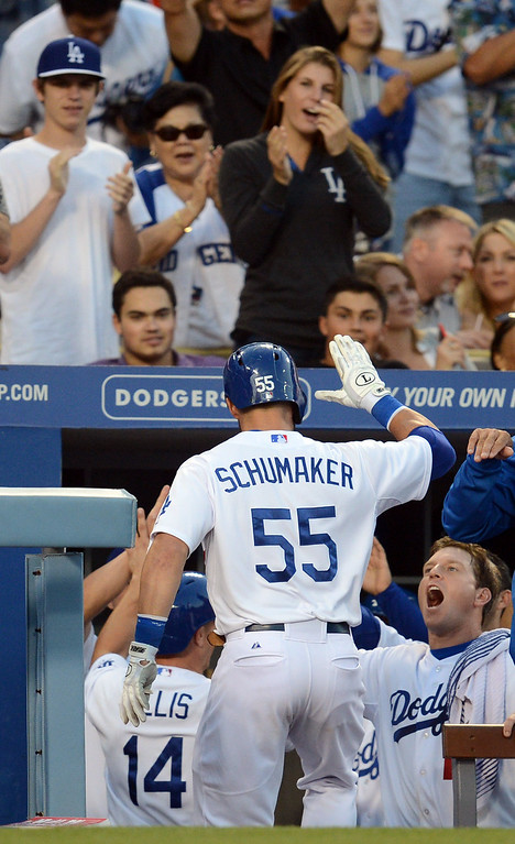 . The Dodgers\' Skip Schumaker #55 enters the dugout  after hitting a 2 run homer in the 5th inning during their game against the Reds  at Dodger Stadium in Los Angeles Saturday, July 27, 2013. (Hans Gutknecht/Los Angeles Daily News)