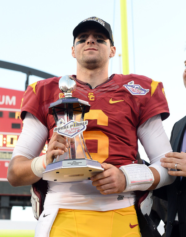 . LAS VEGAS, NV - DECEMBER 21: Quarterback Cody Kessler #6 of the USC Trojans holds the MVP trophy after USC defeated the Fresno State Bulldogs 45-20 to win the Royal Purple Las Vegas Bowl at Sam Boyd Stadium on December 21, 2013 in Las Vegas, Nevada.  (Photo by Ethan Miller/Getty Images)