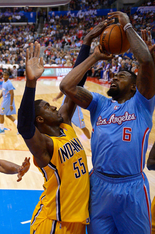 . Los Angeles Clippers center DeAndre Jordan, right, has his shot blocked by Indiana Pacers center Roy Hibbert during the first half of an NBA basketball game, Sunday, Dec. 1, 2013, in Los Angeles. (AP Photo/Mark J. Terrill)