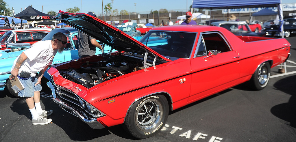 . Car show judge Mike Roads looks over a 1969 Chevy El Camino during the 4th annual La Habra Highlanders car show at La Habra High School in La Habra Calif. on Saturday, Sept. 7, 2013.   (Photo by Keith Birmingham/Pasadena Star-News)