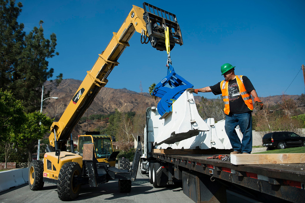 . Workers install K-rails along 800 block of Rainbow Drive on Tuesday, Feb. 25, 2014 as the City of Glendora prepares for two major rainstorms that will hit the region this week that potentially will cause mudslides in the area devastated by the Colby Fire. (Photo by Watchara Phomicinda/ San Gabriel Valley)