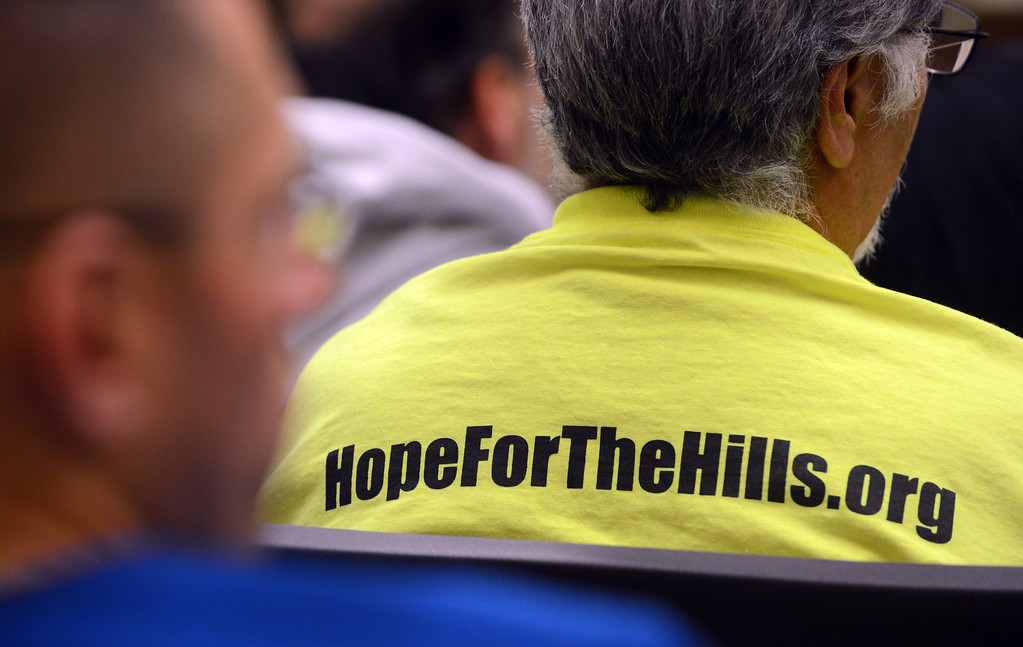 . A Hope For The Hills supporter listens as the City of Chino Hills holds a Town Hall Meeting about the Tehachapi Renewable Transmission Project at City Hall in Chino Hills.  (Staff photo/Inland Valley Daily Bulletin)