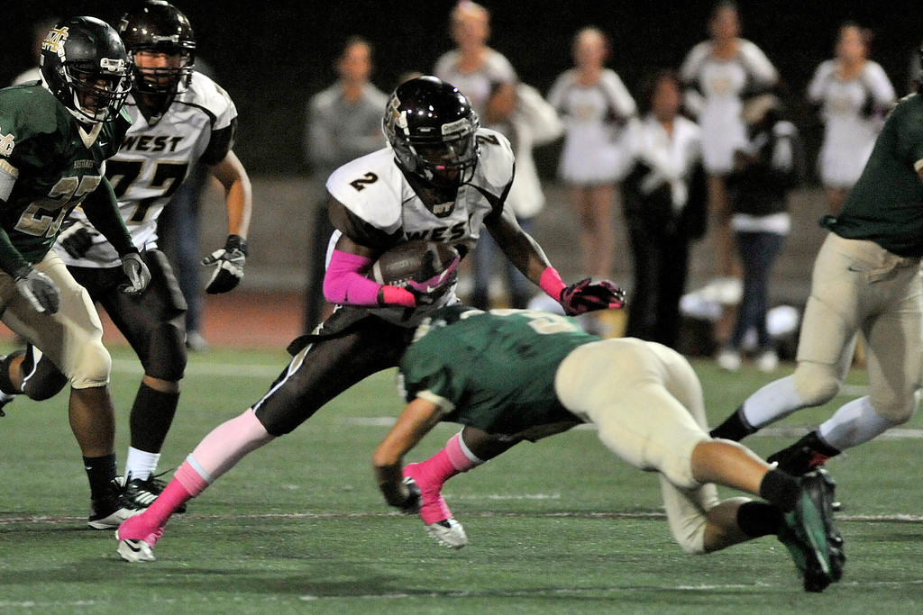 . MANHATTAN BEACH - 10/11/2013 - (Mark Savage) Bay League opening football game between West Torrance High School and Mira Costa High School at Mira Costa. West Torrance player Brett Ojiyi gains yards against Mira Costa in the first quarter.