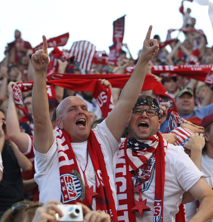 . Fans react after USA scores in the second half during an World Cup qualifying soccer match against Honduras at Rio Tinto Stadium on Tuesday, June 18, 2013, in Sandy, Utah. USA defeated Honduras 1-0. (AP Photo/Rick Bowmer)