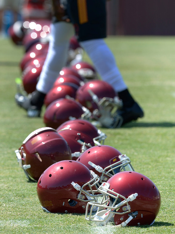 . Clean, new football helmets on the 50-yard line before practice. Football practice is in full swing on the Howard Jones Field at USC. Los Angeles, CA. 8/6/2014(Photo by John McCoy Daily News)