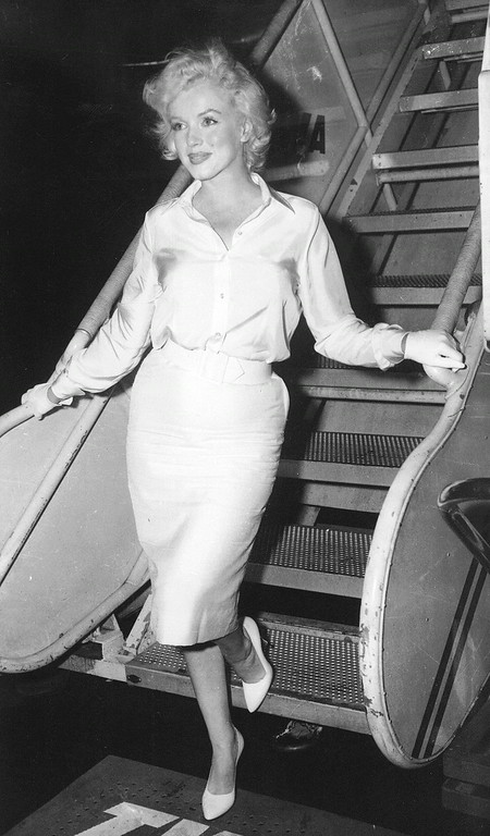 ". In this July 7, 1958 file photo, actress Marilyn Monroe leaves New York by air for Hollywood, to start work on ""Some Like It Hot,\"" her first film in two years. (AP Photo, File)"