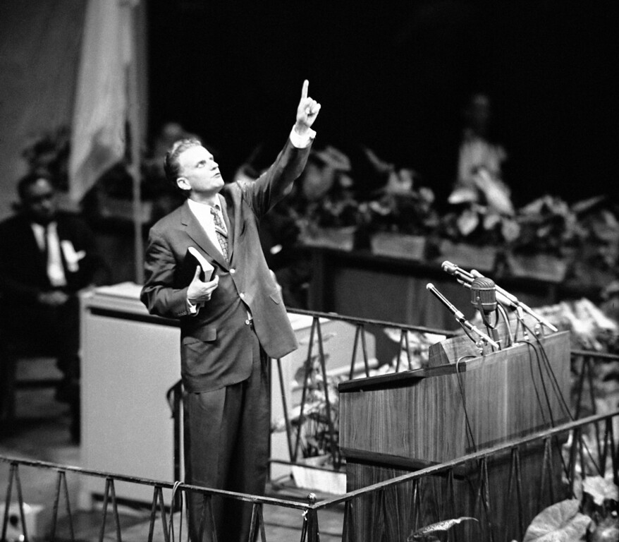 """. Evangelist Billy Graham is shown speaking at Madison Square Garden, New York City  May 15, 1957 as he opens his crusade for \""""A Spiritual Revolution in the City.\"""" (AP Photo)"""
