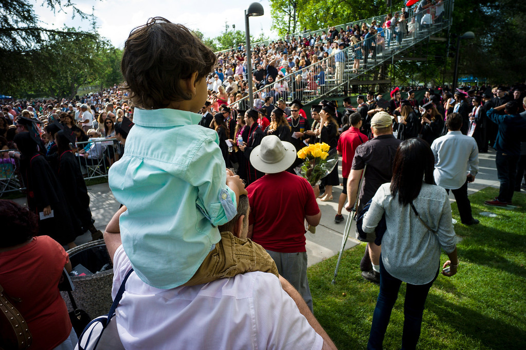 . Spectators watch CSUN grads march in for graduation ceremonies at Cal State Northridge Monday, May 19, 2014.  ( Photo by David Crane/Los Angeles Daily News )