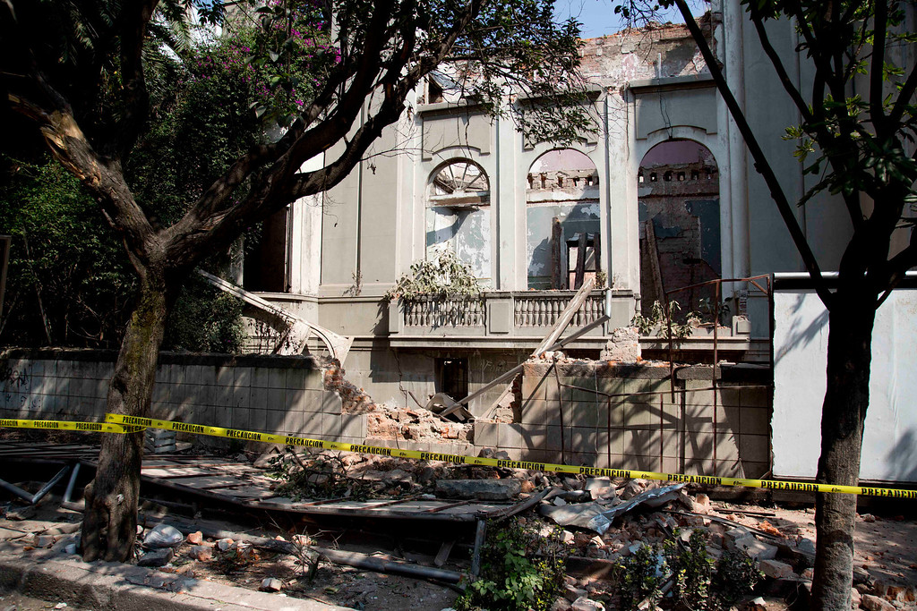 . A damaged abandoned house is seen at the Juarez neighborhood after a strong earthquake jolted Mexico City, Friday, April 18, 2014. A powerful magnitude-7.2 earthquake shook central and southern Mexico but there were no early reports of major damage or casualties. (AP Photo/Eduardo Verdugo)